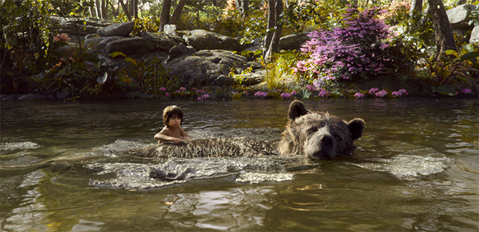 Neel Sethi is Mowgli and Bill Murray is Baloo in The Jungle Book